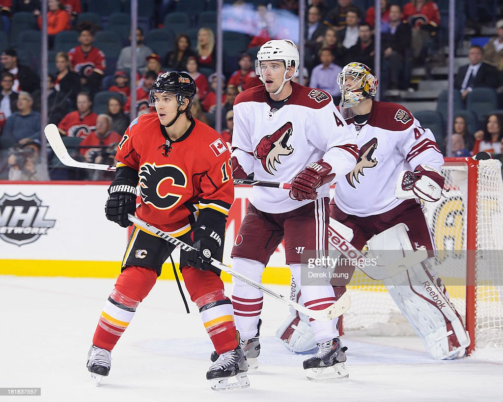 <a gi-track='captionPersonalityLinkClicked' href=/galleries/search?phrase=Mikael+Backlund&family=editorial&specificpeople=4324942 ng-click='$event.stopPropagation()'>Mikael Backlund</a> #11 of the Calgary Flames looks for an opportunity as <a gi-track='captionPersonalityLinkClicked' href=/galleries/search?phrase=Zbynek+Michalek&family=editorial&specificpeople=243230 ng-click='$event.stopPropagation()'>Zbynek Michalek</a> #4 and Mike Smith of the Phoenix Coyotes defend net during a preseason NHL game at Scotiabank Saddledome on September 25, 2013 in Calgary, Alberta, Canada.