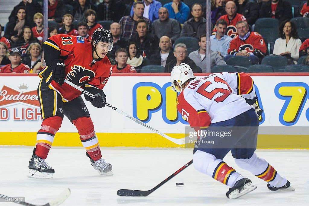 Mikael Backlund #11 of the Calgary Flames looks to check Brian Campbell #51 of the Florida Panthers during an NHL game at Scotiabank Saddledome on November 22, 2013 in Calgary, Alberta, Canada. The Flames defeated the Panthers 4-3 in shootout.