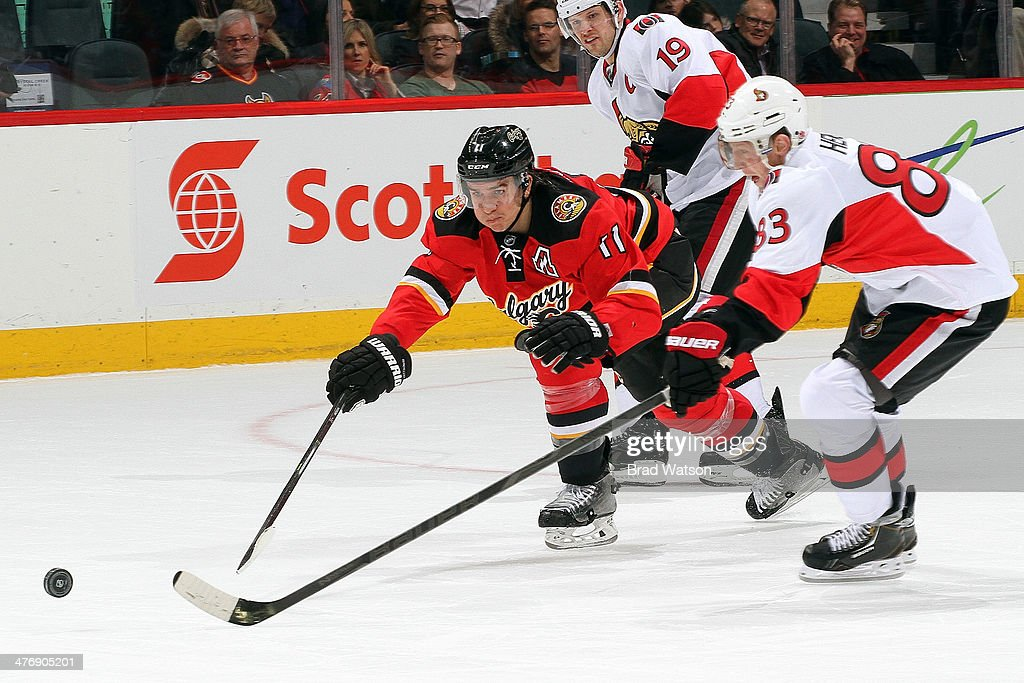 <a gi-track='captionPersonalityLinkClicked' href=/galleries/search?phrase=Mikael+Backlund&family=editorial&specificpeople=4324942 ng-click='$event.stopPropagation()'>Mikael Backlund</a> #11 of the Calgary Flames skates against <a gi-track='captionPersonalityLinkClicked' href=/galleries/search?phrase=Ales+Hemsky&family=editorial&specificpeople=202828 ng-click='$event.stopPropagation()'>Ales Hemsky</a> #83 of the Ottawa Senators at Scotiabank Saddledome on March 5, 2014 in Calgary, Alberta, Canada.