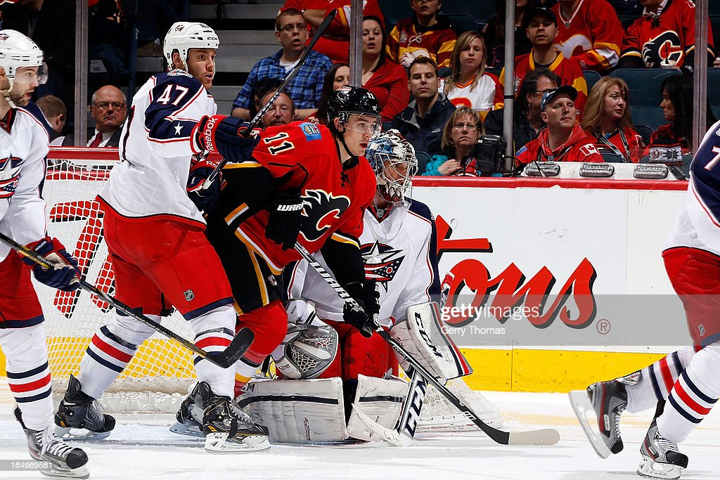 <a gi-track='captionPersonalityLinkClicked' href=/galleries/search?phrase=Mikael+Backlund&family=editorial&specificpeople=4324942 ng-click='$event.stopPropagation()'>Mikael Backlund</a> #11 of the Calgary Flames skates against <a gi-track='captionPersonalityLinkClicked' href=/galleries/search?phrase=Dalton+Prout&family=editorial&specificpeople=6263673 ng-click='$event.stopPropagation()'>Dalton Prout</a> #47 of the Columbus Blue Jackets on March 29, 2013 at the Scotiabank Saddledome in Calgary, Alberta, Canada.