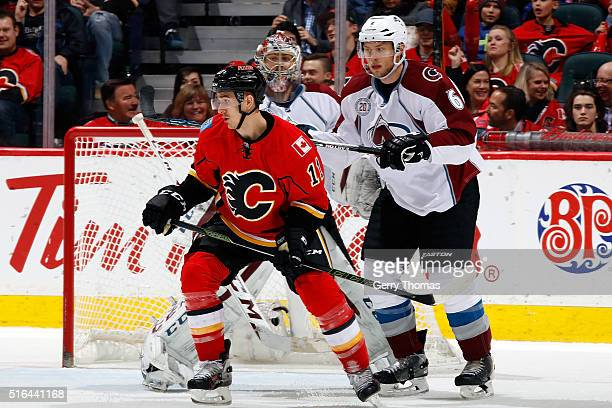 Mikael Backlund of the Calgary Flames skates against Erik Johnson of the Colorado Avalanche during an NHL game at Scotiabank Saddledome on March 18...