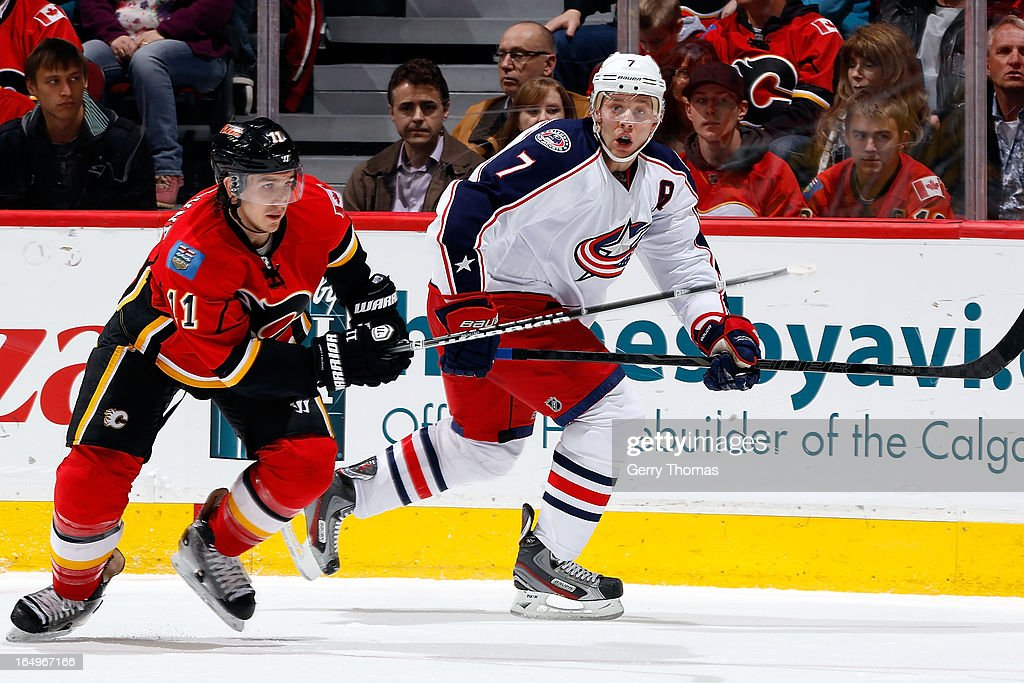 <a gi-track='captionPersonalityLinkClicked' href=/galleries/search?phrase=Mikael+Backlund&family=editorial&specificpeople=4324942 ng-click='$event.stopPropagation()'>Mikael Backlund</a> #11 of the Calgary Flames skates against Jack Johnson #7 of the Columbus Blue Jackets on March 29, 2013 at the Scotiabank Saddledome in Calgary, Alberta, Canada.