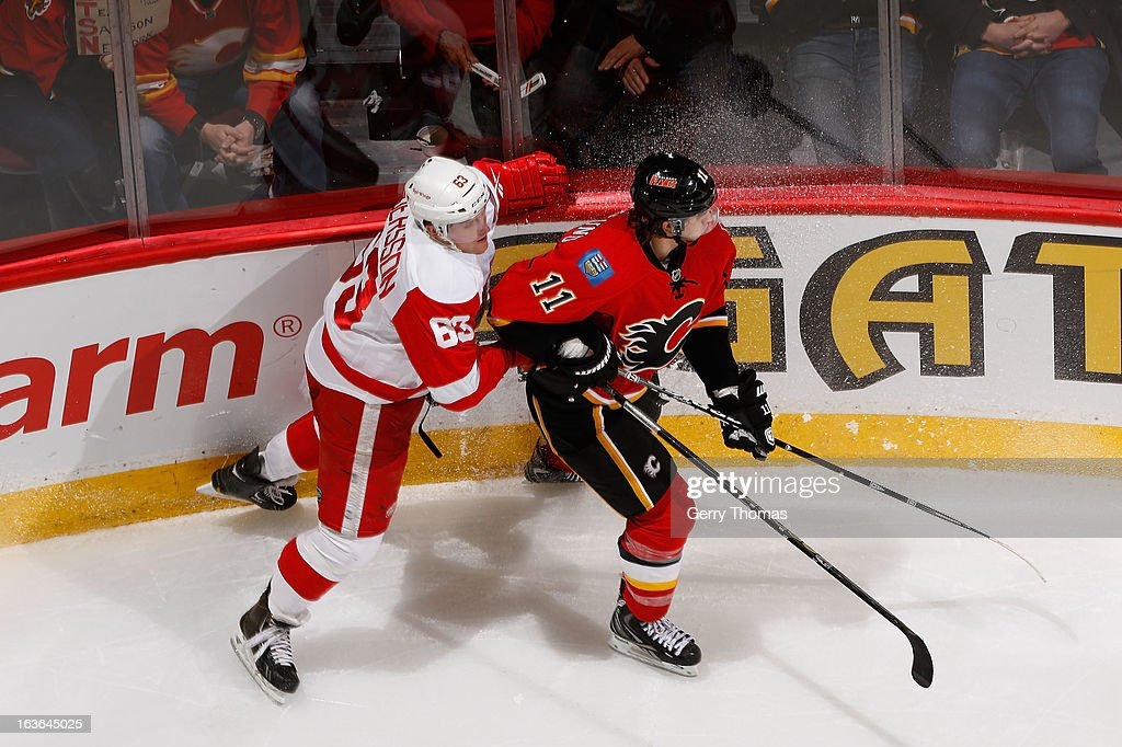 <a gi-track='captionPersonalityLinkClicked' href=/galleries/search?phrase=Mikael+Backlund&family=editorial&specificpeople=4324942 ng-click='$event.stopPropagation()'>Mikael Backlund</a> #11 of the Calgary Flames skates against Joakim Andersson #63 of the Detroit Red Wings on March 13, 2013 at the Scotiabank Saddledome in Calgary, Alberta, Canada.