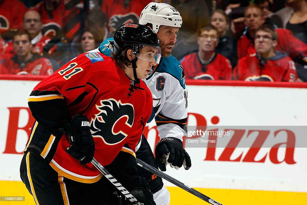<a gi-track='captionPersonalityLinkClicked' href=/galleries/search?phrase=Mikael+Backlund&family=editorial&specificpeople=4324942 ng-click='$event.stopPropagation()'>Mikael Backlund</a> #11 of the Calgary Flames skates against <a gi-track='captionPersonalityLinkClicked' href=/galleries/search?phrase=Joe+Thornton&family=editorial&specificpeople=201829 ng-click='$event.stopPropagation()'>Joe Thornton</a> #19 of the San Jose Sharks on January 20, 2013 at the Scotiabank Saddledome in Calgary, Alberta, Canada.