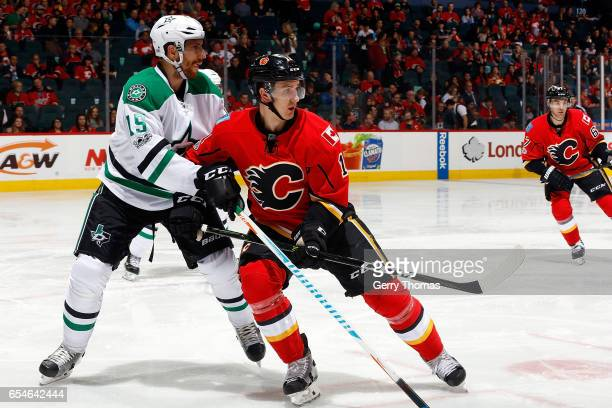 Mikael Backlund of the Calgary Flames skates against Patrik Nemeth of the Dallas Stars during an NHL game on March 17 2017 at the Scotiabank...