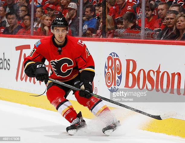 Mikael Backlund of the Calgary Flames skates against the Edmonton Oilers at Scotiabank Saddledome on October 17 2015 in Calgary Alberta Canada