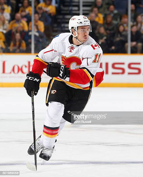 Mikael Backlund of the Calgary Flames skates against the Nashville Predators during an NHL game at Bridgestone Arena on December 15 2015 in Nashville...