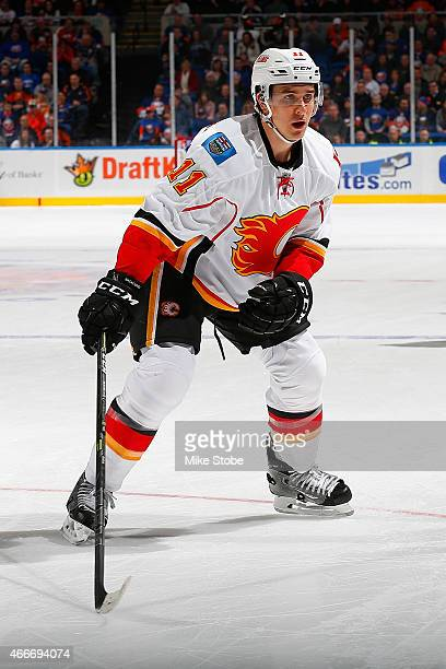 Mikael Backlund of the Calgary Flames skates against the New York Islanders at Nassau Veterans Memorial Coliseum on February 27 2015 in Uniondale New...