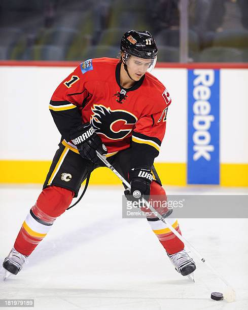 Mikael Backlund of the Calgary Flames skates against the Phoenix Coyotes during a preseason NHL game at Scotiabank Saddledome on September 25 2013 in...