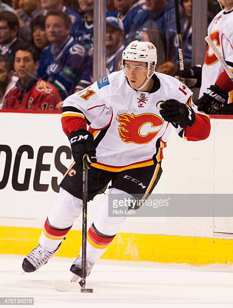 Mikael Backlund of the Calgary Flames skates with the puck in Game One of the Western Conference Quarterfinals against the Vancouver Canucks during...