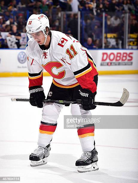 Mikael Backlund of the Calgary Flames waits for a face off against the St Louis Blues on October 11 2014 at Scottrade Center in St Louis Missouri