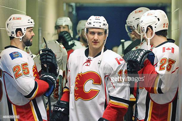 Mikael Backlund of the Calgary Flames walks from the locker room to the ice surface for warmups prior to his game against the Philadelphia Flyers on...