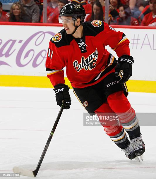 Mikael Backlund#11 of the Calgary Flames skates against the Detroit Red Wings at Scotiabank Saddledome on October 23 2015 in Calgary Alberta Canada