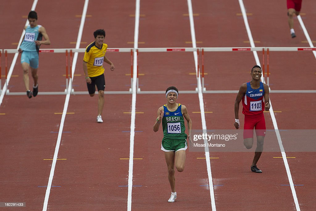 Mikael de Jesus of Brazil leads during Men's 400mts Hurdles event as part of the I ODESUR South American Youth Games at Estadio Miguel Grau on September 29, 2013 in Lima, Peru.