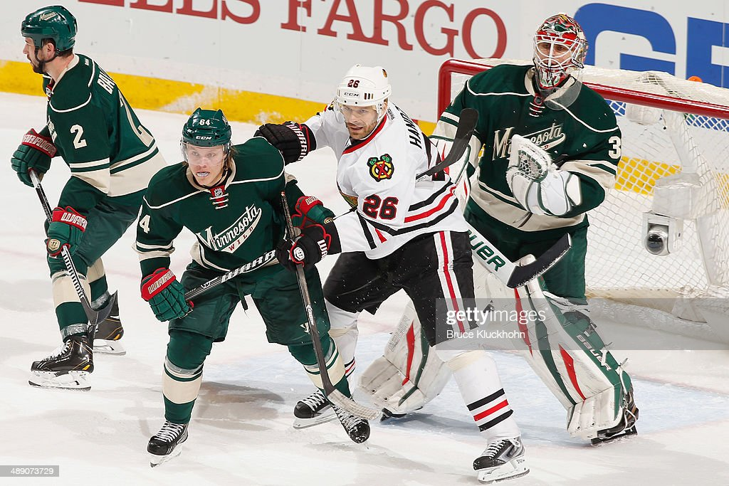 Mikael Granlund #64 and goalie Ilya Bryzgalov #30 of the Minnesota Wild defend against Michal Handzus #26 of the Chicago Blackhawks during Game Four of the Second Round of the 2014 Stanley Cup Playoffs on May 9, 2014 at the Xcel Energy Center in St. Paul, Minnesota.