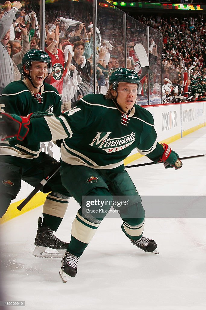 Mikael Granlund #64 and Jonas Brodin #25 of the Minnesota Wild celebrate after scoring a goal against the Chicago Blackhawks during Game Three of the Second Round of the 2014 Stanley Cup Playoffs on May 6, 2014 at the Xcel Energy Center in St. Paul, Minnesota.