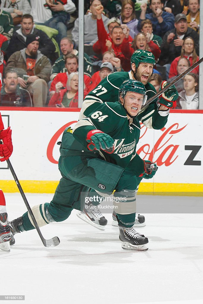 <a gi-track='captionPersonalityLinkClicked' href=/galleries/search?phrase=Mikael+Granlund&family=editorial&specificpeople=5649678 ng-click='$event.stopPropagation()'>Mikael Granlund</a> #64 and Mike Rupp #27 of the Minnesota Wild celebrate after their team scores a goal against the Detroit Red Wings during the game on February 17, 2013 at the Xcel Energy Center in Saint Paul, Minnesota.
