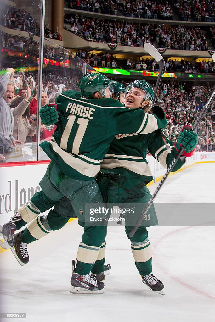 <a gi-track='captionPersonalityLinkClicked' href=/galleries/search?phrase=Mikael+Granlund&family=editorial&specificpeople=5649678 ng-click='$event.stopPropagation()'>Mikael Granlund</a> #64 celebrates with his Minnesota Wild teammate <a gi-track='captionPersonalityLinkClicked' href=/galleries/search?phrase=Zach+Parise&family=editorial&specificpeople=213606 ng-click='$event.stopPropagation()'>Zach Parise</a> #11 after scoring a goal against the Chicago Blackhawks during Game Three of the Second Round of the 2014 Stanley Cup Playoffs on May 6, 2014 at the Xcel Energy Center in St. Paul, Minnesota.
