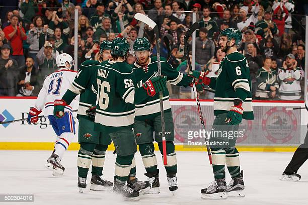 Mikael Granlund Erik Haula Jason Pominville and Marco Scandella of the Minnesota Wild celebrate after scoring a goal against the Montreal Canadiens...