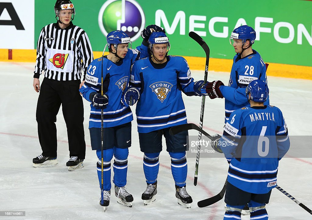 <a gi-track='captionPersonalityLinkClicked' href=/galleries/search?phrase=Mikael+Granlund&family=editorial&specificpeople=5649678 ng-click='$event.stopPropagation()'>Mikael Granlund</a> (C) of Finland celebrate with his team mates after he scores his team's 2nd goal uring the IIHF World Championship group H match between Latvia and Finland at Hartwall Areena on May 14, 2013 in Helsinki, Finland.