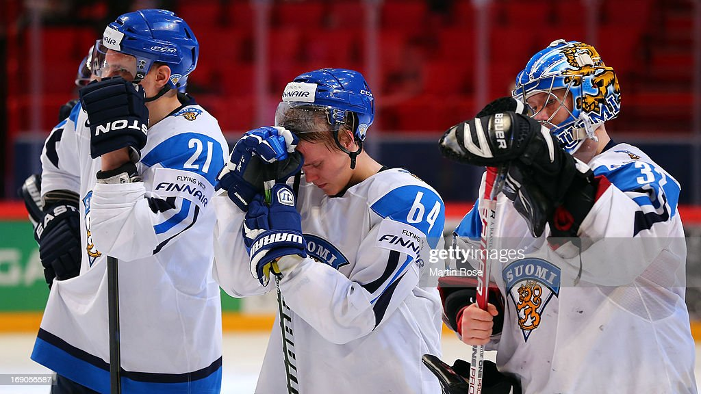 <a gi-track='captionPersonalityLinkClicked' href=/galleries/search?phrase=Mikael+Granlund&family=editorial&specificpeople=5649678 ng-click='$event.stopPropagation()'>Mikael Granlund</a> (C) of Finland looks dejected after the IIHF World Championship third place match between Finland and USA at Globen Arena on May 19, 2013 in Stockholm, Sweden.