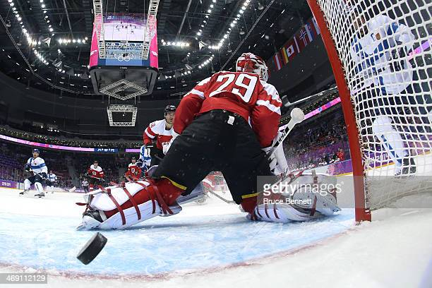Mikael Granlund of Finland scores a goal in the first period against Bernhard Starkbaum of Austria during the Men's Ice Hockey Preliminary Round...