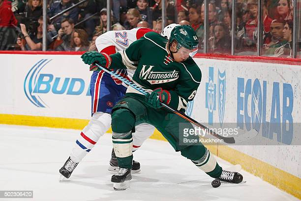Mikael Granlund of the Minnesota Wild and Alex Galchenyuk of the Montreal Canadiens battle for the puck during the game on December 22 2015 at the...