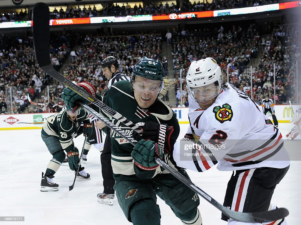 Mikael Granlund #64 of the Minnesota Wild and Duncan Keith #2 of the Chicago Blackhawks skate after the puck during the second period in Game Four of the Second Round of the 2014 NHL Stanley Cup Playoffs on May 9, 2014 at Xcel Energy Center in St Paul, Minnesota.