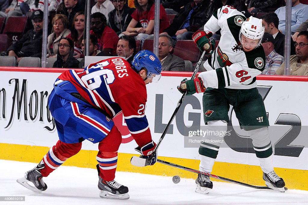 <a gi-track='captionPersonalityLinkClicked' href=/galleries/search?phrase=Mikael+Granlund&family=editorial&specificpeople=5649678 ng-click='$event.stopPropagation()'>Mikael Granlund</a> #64 of the Minnesota Wild and <a gi-track='captionPersonalityLinkClicked' href=/galleries/search?phrase=Josh+Gorges&family=editorial&specificpeople=550446 ng-click='$event.stopPropagation()'>Josh Gorges</a> #26 of the Montreal Canadiens battle for the puck during the NHL game at the Bell Centre on November 19, 2013 in Montreal, Quebec, Canada. The Canadiens defeated the Wild 6-2.