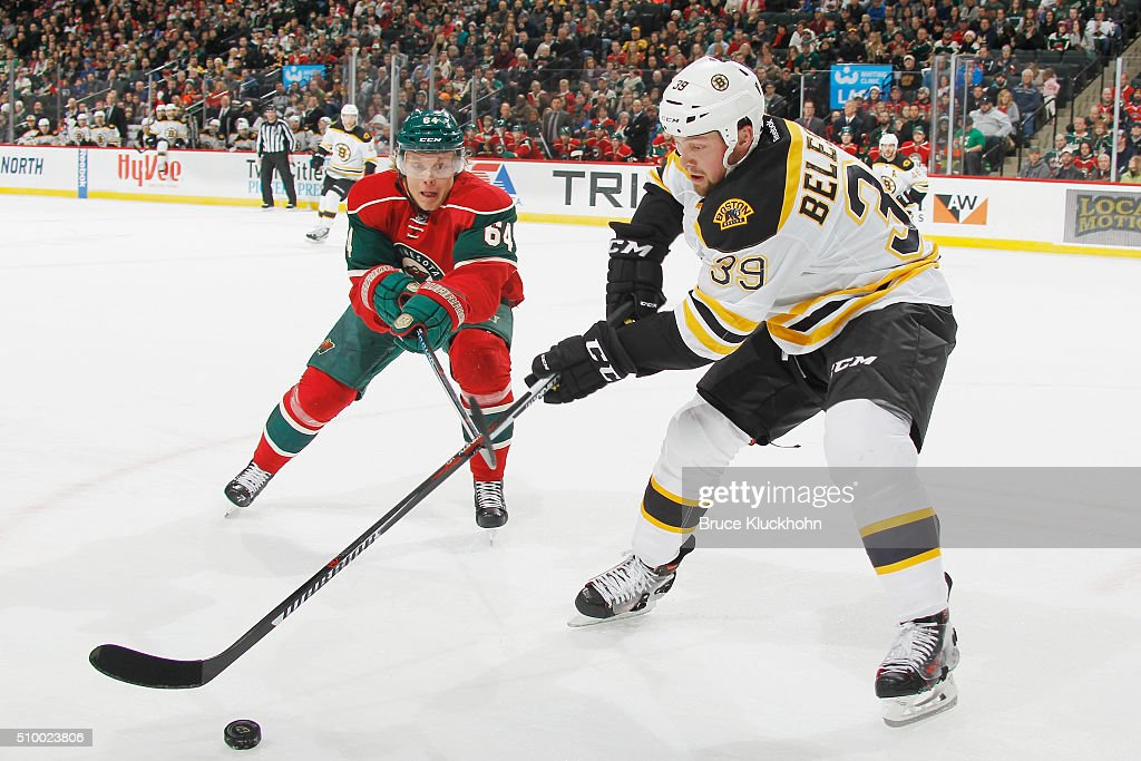 <a gi-track='captionPersonalityLinkClicked' href=/galleries/search?phrase=Mikael+Granlund&family=editorial&specificpeople=5649678 ng-click='$event.stopPropagation()'>Mikael Granlund</a> #64 of the Minnesota Wild and <a gi-track='captionPersonalityLinkClicked' href=/galleries/search?phrase=Matt+Beleskey&family=editorial&specificpeople=570471 ng-click='$event.stopPropagation()'>Matt Beleskey</a> #39 of the Boston Bruins skate to the puck during the game on February 13, 2016 at the Xcel Energy Center in St. Paul, Minnesota.