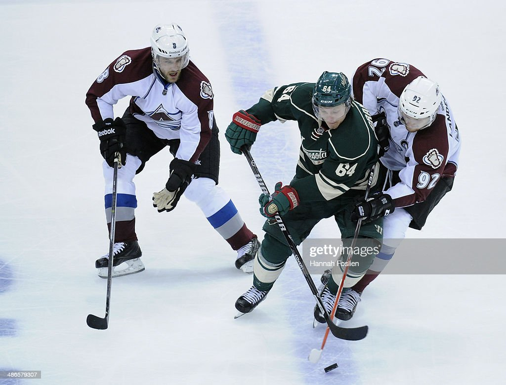 <a gi-track='captionPersonalityLinkClicked' href=/galleries/search?phrase=Mikael+Granlund&family=editorial&specificpeople=5649678 ng-click='$event.stopPropagation()'>Mikael Granlund</a> #64 of the Minnesota Wild controls the puck against <a gi-track='captionPersonalityLinkClicked' href=/galleries/search?phrase=Jan+Hejda&family=editorial&specificpeople=624333 ng-click='$event.stopPropagation()'>Jan Hejda</a> #8 and <a gi-track='captionPersonalityLinkClicked' href=/galleries/search?phrase=Gabriel+Landeskog&family=editorial&specificpeople=6590816 ng-click='$event.stopPropagation()'>Gabriel Landeskog</a> #92 of the Colorado Avalanche during the second period in Game Four of the First Round of the 2014 NHL Stanley Cup Playoffs on April 24, 2014 at Xcel Energy Center in St Paul, Minnesota. The Wild defeated the Avalanche 2-1.