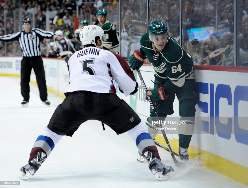 <a gi-track='captionPersonalityLinkClicked' href=/galleries/search?phrase=Mikael+Granlund&family=editorial&specificpeople=5649678 ng-click='$event.stopPropagation()'>Mikael Granlund</a> #64 of the Minnesota Wild controls the puck against <a gi-track='captionPersonalityLinkClicked' href=/galleries/search?phrase=Nate+Guenin&family=editorial&specificpeople=3948510 ng-click='$event.stopPropagation()'>Nate Guenin</a> #5 of the Colorado Avalanche during the second period in Game Three of the First Round of the 2014 NHL Stanley Cup Playoffs on April 21, 2014 at Xcel Energy Center in St Paul, Minnesota. The Wild defeated the Avalanche 1-0 in overtime.