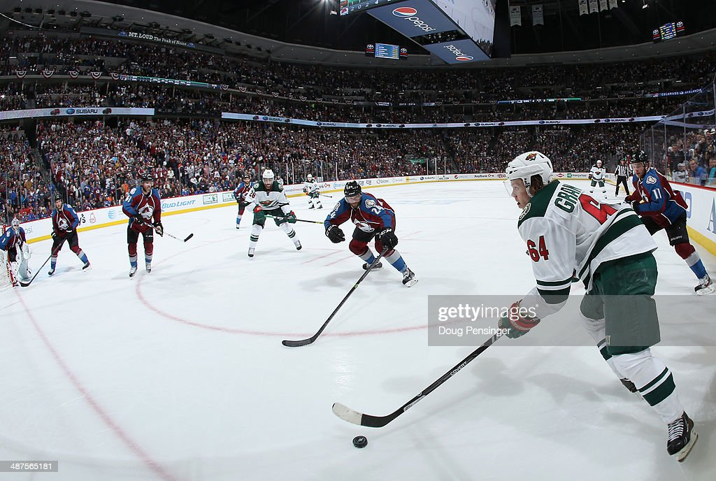 Mikael Granlund #64 of the Minnesota Wild controls the puck against the Colorado Avalanche in Game Seven of the First Round of the 2014 NHL Stanley Cup Playoffs at Pepsi Center on April 30, 2014 in Denver, Colorado. The Wild defeated the Avalanche in overtime 5-4 to win the series.