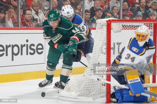 Mikael Granlund of the Minnesota Wild controls the puck with Ivan Barbashev of the St Louis Blues defending in Game One of the Western Conference...