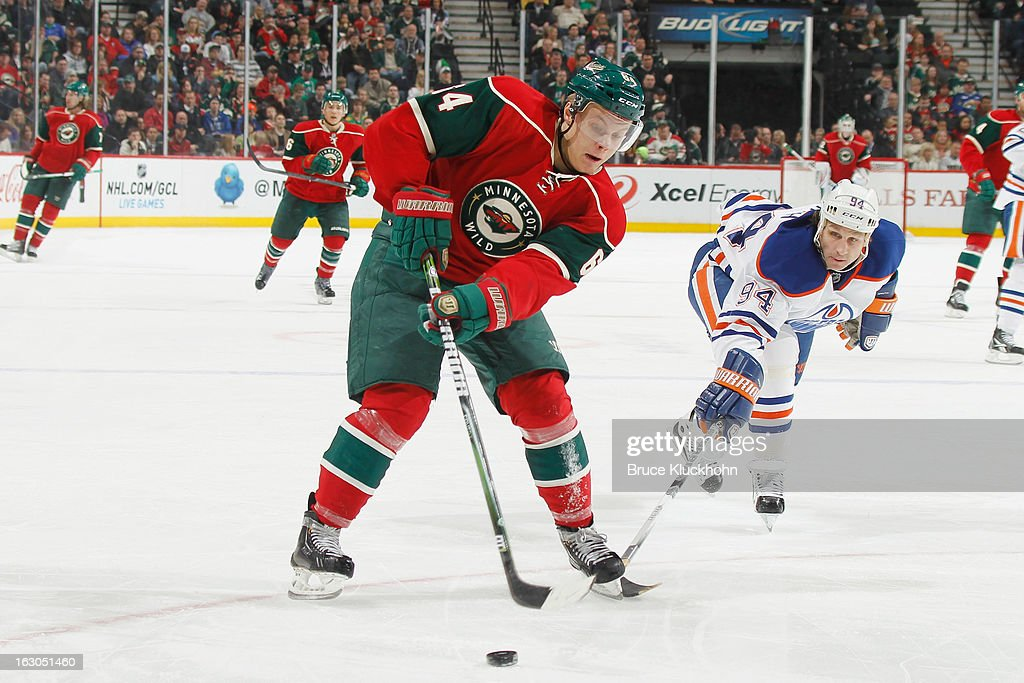 <a gi-track='captionPersonalityLinkClicked' href=/galleries/search?phrase=Mikael+Granlund&family=editorial&specificpeople=5649678 ng-click='$event.stopPropagation()'>Mikael Granlund</a> #64 of the Minnesota Wild handles the puck with <a gi-track='captionPersonalityLinkClicked' href=/galleries/search?phrase=Ryan+Smyth+-+Ice+Hockey+Player&family=editorial&specificpeople=202567 ng-click='$event.stopPropagation()'>Ryan Smyth</a> #94 of the Edmonton Oilers defending during the game on March 3, 2013 at the Xcel Energy Center in Saint Paul, Minnesota.