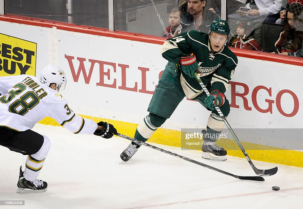 <a gi-track='captionPersonalityLinkClicked' href=/galleries/search?phrase=Mikael+Granlund&family=editorial&specificpeople=5649678 ng-click='$event.stopPropagation()'>Mikael Granlund</a> #64 of the Minnesota Wild passes the puck around <a gi-track='captionPersonalityLinkClicked' href=/galleries/search?phrase=Vernon+Fiddler&family=editorial&specificpeople=208086 ng-click='$event.stopPropagation()'>Vernon Fiddler</a> #38 of the Dallas Stars during the first period of the game on January 20, 2013 at Xcel Energy Center in St Paul, Minnesota. The Wild defeated the Stars 1-0.