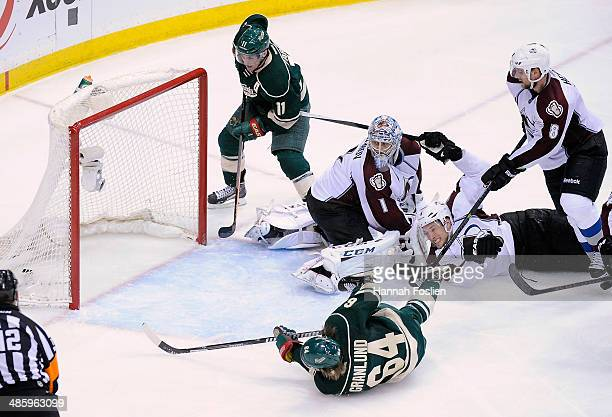 Mikael Granlund of the Minnesota Wild shoots the puck as teammate Zach Parise looks on along with Semyon Varlamov Erik Johnson and Jan Hejda of the...