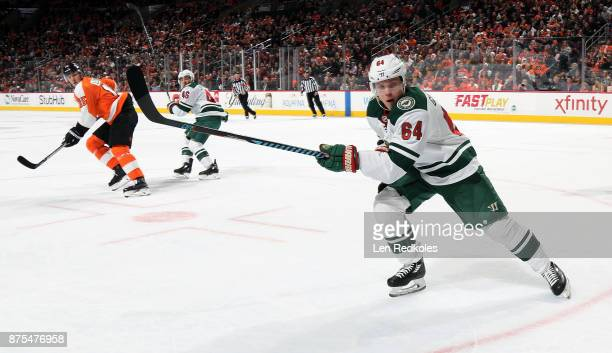 Mikael Granlund of the Minnesota Wild skates against Jori Lehtera of the Philadelphia Flyers on November 11 2017 at the Wells Fargo Center in...