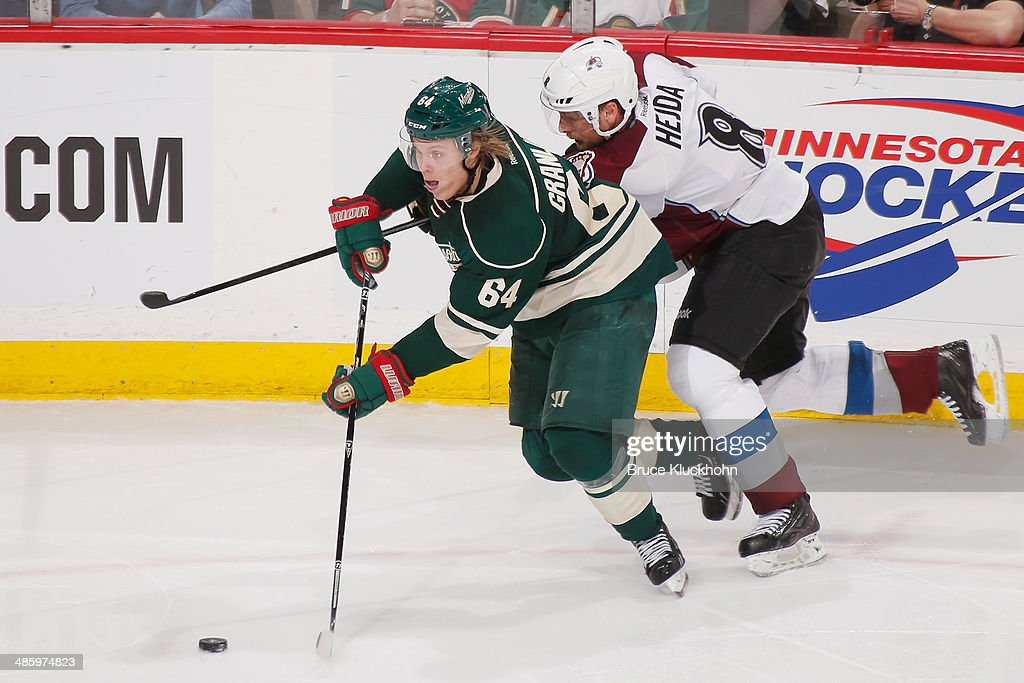 <a gi-track='captionPersonalityLinkClicked' href=/galleries/search?phrase=Mikael+Granlund&family=editorial&specificpeople=5649678 ng-click='$event.stopPropagation()'>Mikael Granlund</a> #64 of the Minnesota Wild skates chased by <a gi-track='captionPersonalityLinkClicked' href=/galleries/search?phrase=Jan+Hejda&family=editorial&specificpeople=624333 ng-click='$event.stopPropagation()'>Jan Hejda</a> #8 of the Colorado Avalanche during Game Three of the First Round of the 2014 Stanley Cup Playoffs on April 21, 2014 at the Xcel Energy Center in St. Paul, Minnesota.
