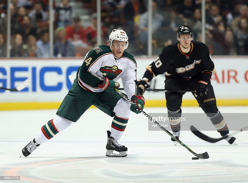 Mikael Granlund #64 of the Minnesota Wild skates with the puck in the second period against the Anaheim Ducks at Honda Center on February 1, 2013 in Anaheim, California. The Ducks defeated the Wild 3-1.