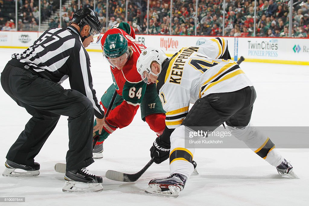 <a gi-track='captionPersonalityLinkClicked' href=/galleries/search?phrase=Mikael+Granlund&family=editorial&specificpeople=5649678 ng-click='$event.stopPropagation()'>Mikael Granlund</a> #64 of the Minnesota Wild takes a face-off against <a gi-track='captionPersonalityLinkClicked' href=/galleries/search?phrase=Joonas+Kemppainen&family=editorial&specificpeople=675818 ng-click='$event.stopPropagation()'>Joonas Kemppainen</a> #41 of the Boston Bruins during the game on February 13, 2016 at the Xcel Energy Center in St. Paul, Minnesota.