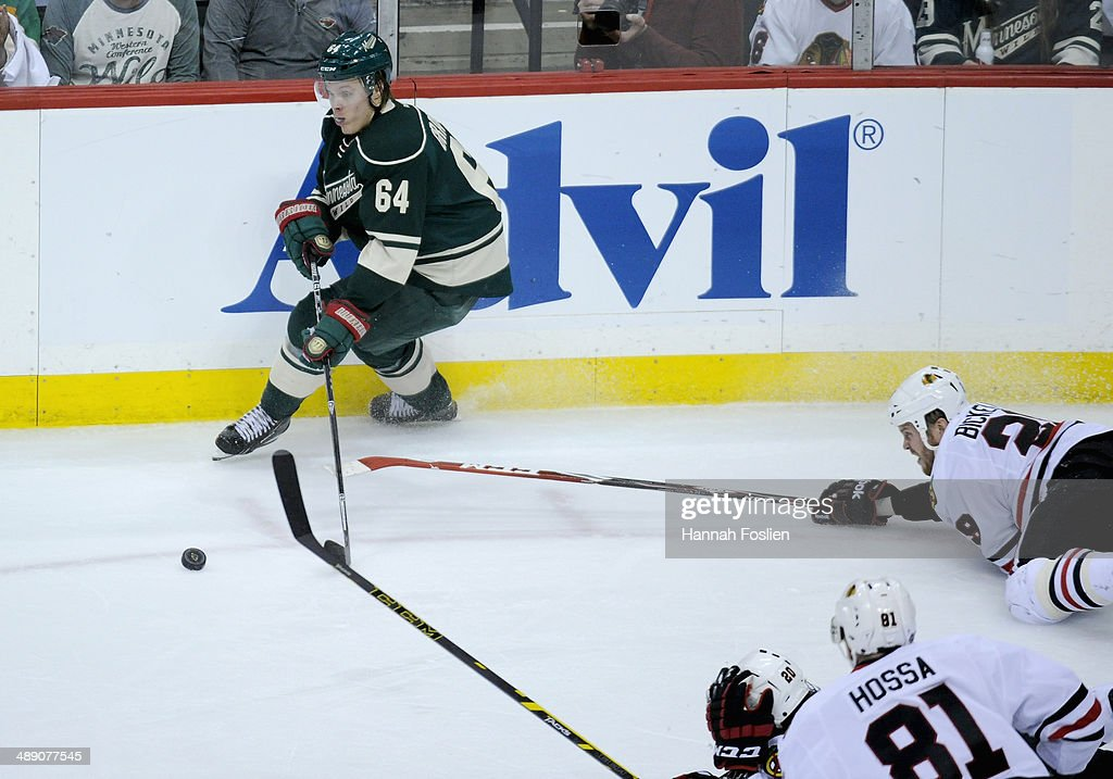 <a gi-track='captionPersonalityLinkClicked' href=/galleries/search?phrase=Mikael+Granlund&family=editorial&specificpeople=5649678 ng-click='$event.stopPropagation()'>Mikael Granlund</a> #64 of the Minnesota Wild takes control of the puck against <a gi-track='captionPersonalityLinkClicked' href=/galleries/search?phrase=Brandon+Saad&family=editorial&specificpeople=7128385 ng-click='$event.stopPropagation()'>Brandon Saad</a> #20, <a gi-track='captionPersonalityLinkClicked' href=/galleries/search?phrase=Marian+Hossa&family=editorial&specificpeople=202233 ng-click='$event.stopPropagation()'>Marian Hossa</a> #81 and <a gi-track='captionPersonalityLinkClicked' href=/galleries/search?phrase=Bryan+Bickell&family=editorial&specificpeople=241498 ng-click='$event.stopPropagation()'>Bryan Bickell</a> #29 of the Chicago Blackhawks during the first period in Game Four of the Second Round of the 2014 NHL Stanley Cup Playoffs on May 9, 2014 at Xcel Energy Center in St Paul, Minnesota. The Wild defeated the Blackhawks 4-2.