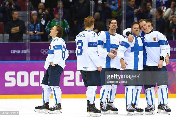 Mikael Granlund Olli Maatta Sami Lepisto Kimmo Timonen and Lasse Kukkonen of Finland celebrate after defeating the United States 50 during the Men's...