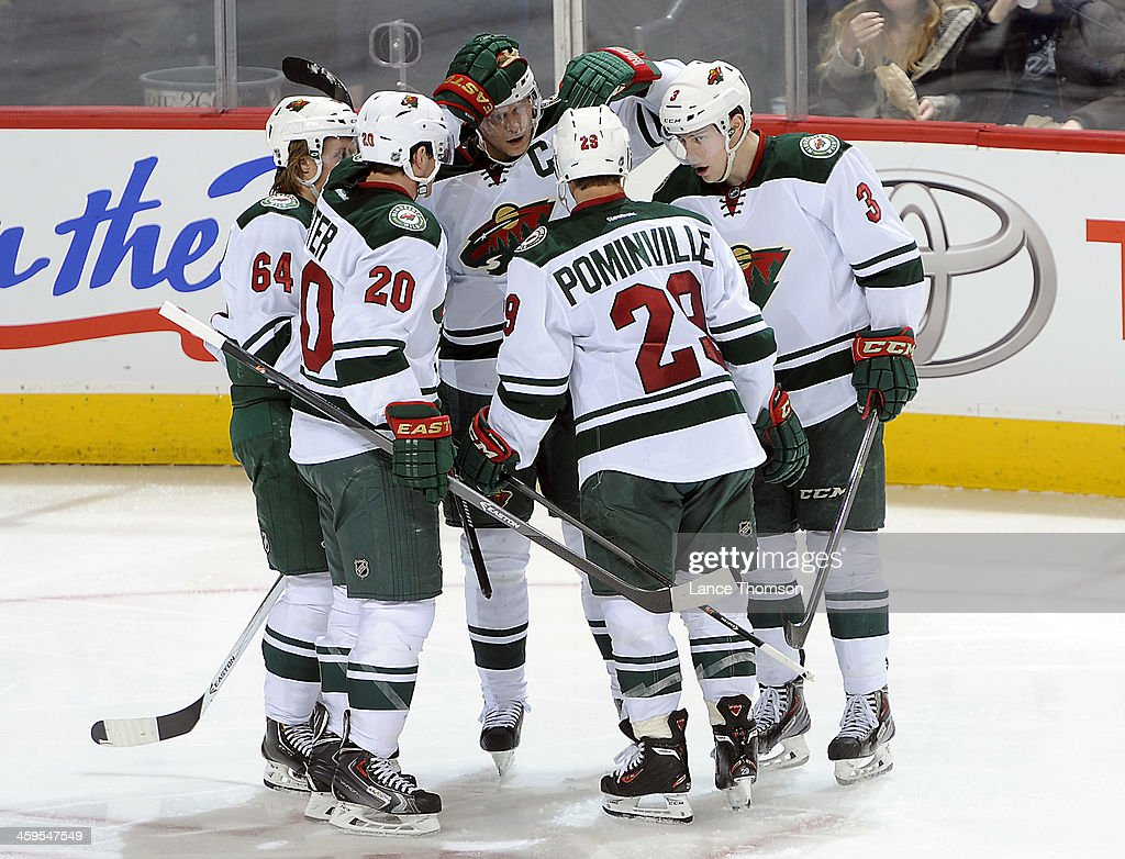 <a gi-track='captionPersonalityLinkClicked' href=/galleries/search?phrase=Mikael+Granlund&family=editorial&specificpeople=5649678 ng-click='$event.stopPropagation()'>Mikael Granlund</a> #64, <a gi-track='captionPersonalityLinkClicked' href=/galleries/search?phrase=Ryan+Suter&family=editorial&specificpeople=583306 ng-click='$event.stopPropagation()'>Ryan Suter</a> #20, <a gi-track='captionPersonalityLinkClicked' href=/galleries/search?phrase=Mikko+Koivu&family=editorial&specificpeople=584987 ng-click='$event.stopPropagation()'>Mikko Koivu</a> #9, <a gi-track='captionPersonalityLinkClicked' href=/galleries/search?phrase=Jason+Pominville&family=editorial&specificpeople=570525 ng-click='$event.stopPropagation()'>Jason Pominville</a> #29 and <a gi-track='captionPersonalityLinkClicked' href=/galleries/search?phrase=Charlie+Coyle&family=editorial&specificpeople=7029381 ng-click='$event.stopPropagation()'>Charlie Coyle</a> #3 of the Minnesota Wild celebrate a second period goal against the Winnipeg Jets at the MTS Centre on December 27, 2013 in Winnipeg, Manitoba, Canada.