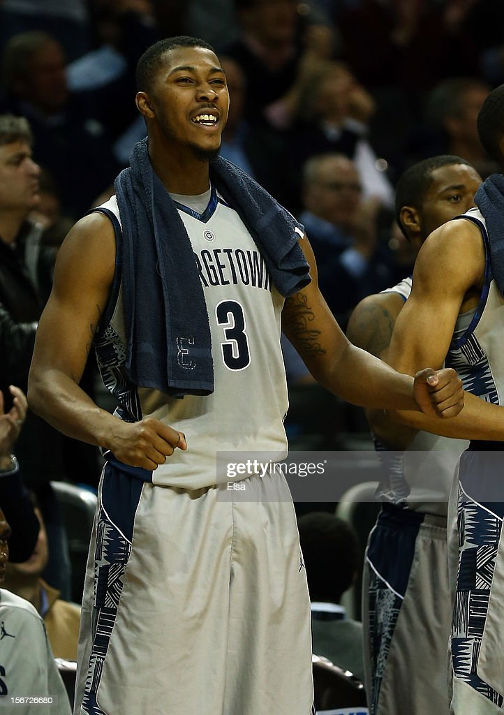Mikael Hopkins #3 of the Georgetown Hoyas celebrates from the bench in the second half against the UCLA Bruins during the Legends Classic on November 19, 2012 at the Barclays Center in the Brooklyn borough of New York City. The Georgetown Hoyas defeated the UCLA Bruins 78-70.