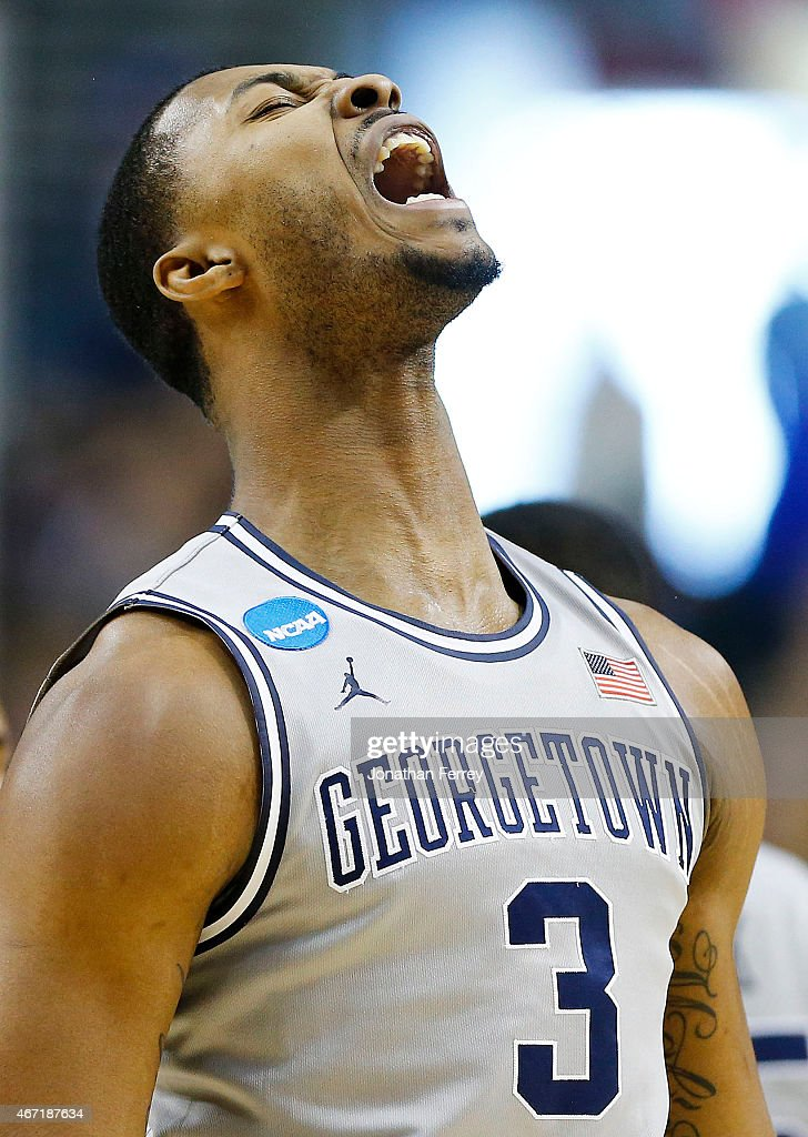 Mikael Hopkins of the Georgetown Hoyas celebrates in the first half against the Utah Utes during the third round of the 2015 NCAA Men's Basketball...
