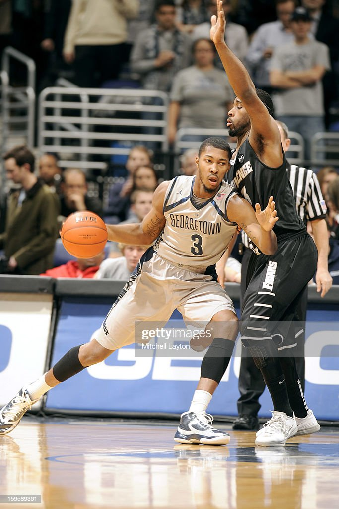 <a gi-track='captionPersonalityLinkClicked' href=/galleries/search?phrase=Mikael+Hopkins&family=editorial&specificpeople=6753587 ng-click='$event.stopPropagation()'>Mikael Hopkins</a> #3 of the Georgetown Hoyas dribbles around Kris Dunn #3 of the Providence Friars during a college basketball game on January 16, 2013 at the Verizon Center in Washington, DC.