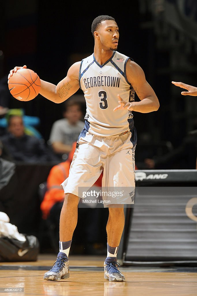 <a gi-track='captionPersonalityLinkClicked' href=/galleries/search?phrase=Mikael+Hopkins&family=editorial&specificpeople=6753587 ng-click='$event.stopPropagation()'>Mikael Hopkins</a> #3 of the Georgetown Hoyas dribbles the ball during a college basketball game against the Charlotte 49ers at the Verizon Center on December 20, 2014 in Washington, DC. The Hoyas won 81-78.