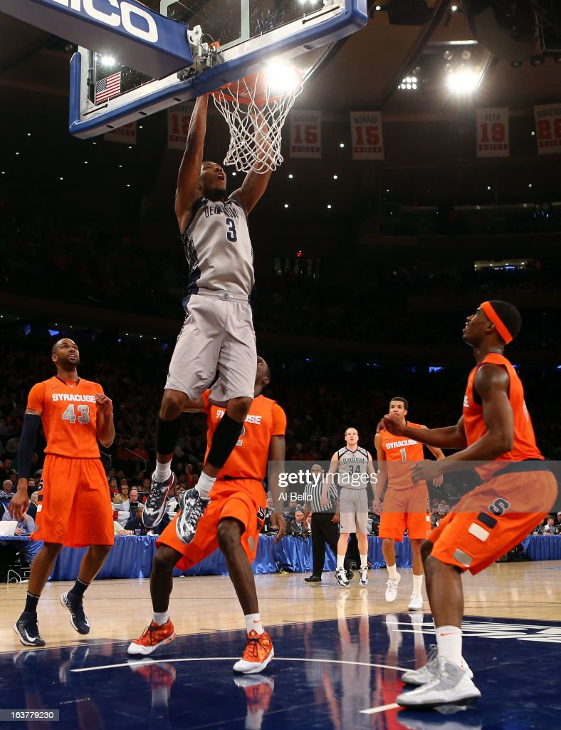 Mikael Hopkins #3 of the Georgetown Hoyas dunks in the second half against the Syracuse Orange during the semifinals of the Big East Men's Basketball Tournament at Madison Square Garden on March 15, 2013 in New York City.