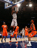 Mikael Hopkins of the Georgetown Hoyas dunks in the second half against the Syracuse Orange during the semifinals of the Big East Men's Basketball...